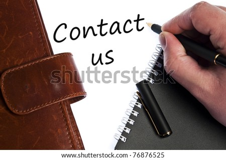 Contact us write by male hand - stock photo