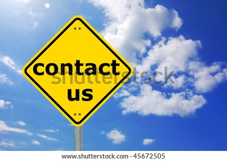 contact us written on a yellow road sign - stock photo