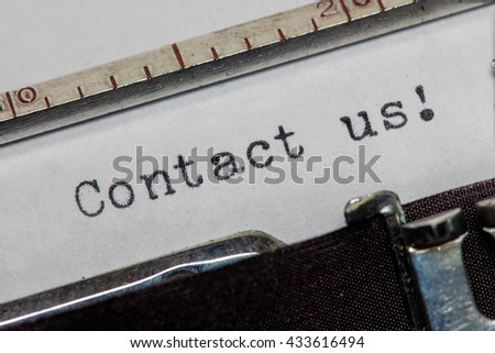 Contact us written on an old typewriter