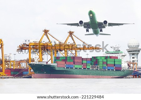 Container at the Dock out door with aircraft flight at airport link.