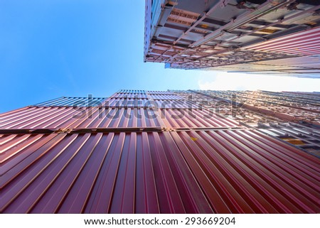 container box at ship yard with blue sky,under view - stock photo