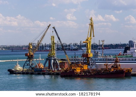 container cargo crane in the dock - stock photo