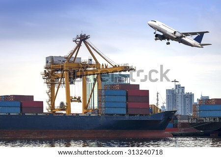 Container Cargo freight ship and Air plan with working crane loading bridge in shipyard at dusk for Logistic Import Export  - stock photo