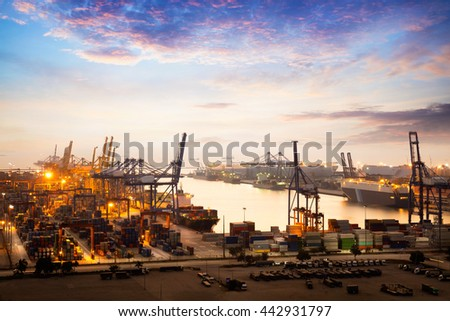 Container Cargo freight ship with working crane bridge in shipyard at dusk for Logistic Import Export background, Import Export Logistic concept