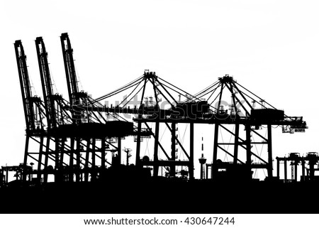 Container Cargo freight ship with working crane bridge in shipyard isolated on white background, Logistic Import Export background concept. Silhouette of Port cranes working in sea port. - stock photo