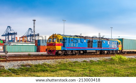 Container Cargo freight trains with Harbour Background using for Logistic Import Export Concept - stock photo