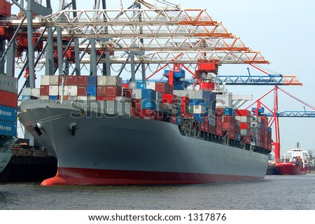 Container Cargo Ship at dockside - stock photo