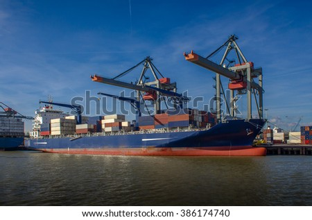 Container cargo ship during loading procedures in the port of Rotterdam.  - stock photo