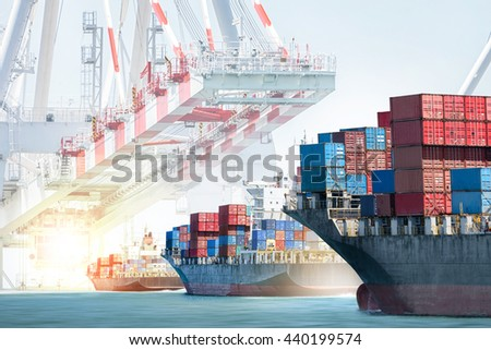 Container cargo ship entering the port with harbor crane background. Freight Transportation. Logistic Import Export background concept. - stock photo