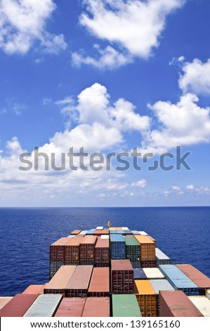 Container cargo ship move to the sea, view from bridge of vessel
