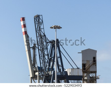 Container crane at dockside with containers ready to be shipped.