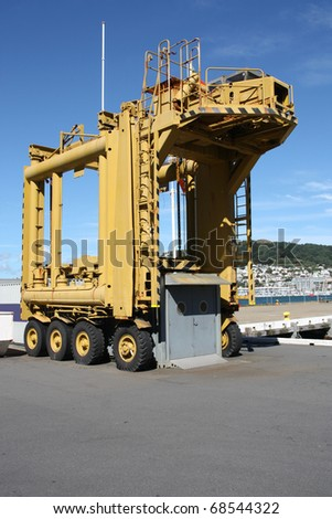 Container crane in Wellington harbor, New Zealand. Heavy lift cargo machinery. Industrial equipment. - stock photo