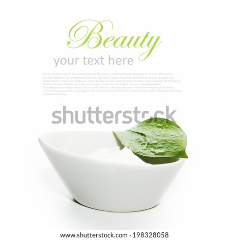 container cream with green leaf isolated on white background - stock photo