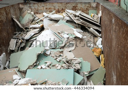 container full of plasterboard and waste