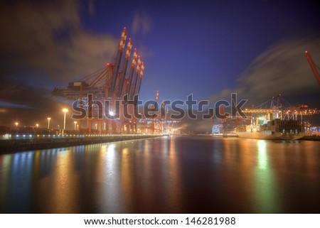 Container harbor at Hamburg, Germany - night shot.  - stock photo