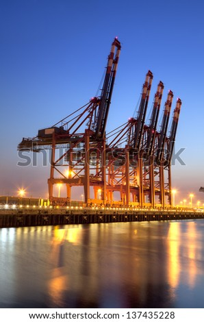 Container Harbor in Hamburg, Germany. Photo shows the crane for the containers. - stock photo