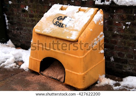 Container of grit and salt for road surfaces in snow blizzard and ice conditions - stock photo