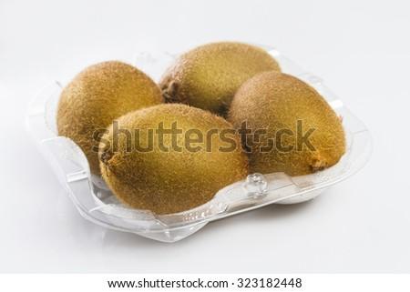 Container of kiwi fruits on white background - stock photo
