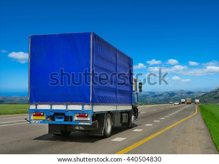 Container on the big highway. transport loads - stock photo