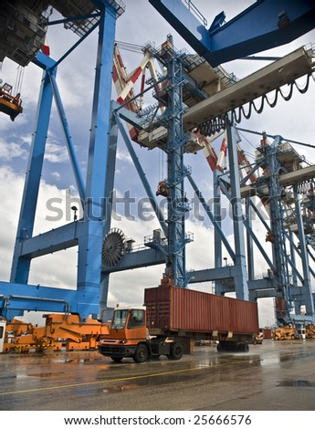 container on track at port on the dock - stock photo