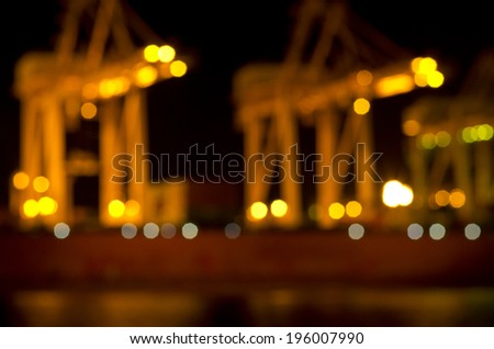 Container port background on dark, out of Focus Lights during the Night - stock photo