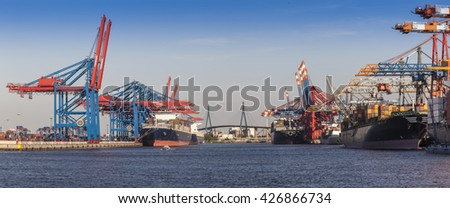 Container Port Panorama at Hamburg in the light of the setting sun, Northern Germany