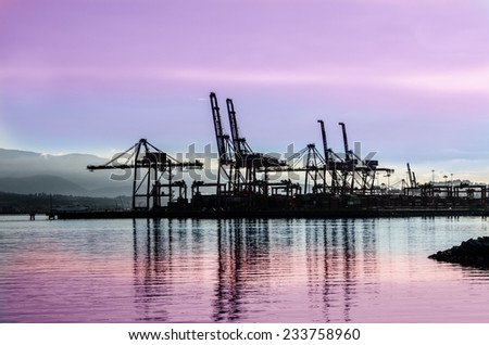 Container port terminal at sunset, sunrise time in Vancouver, Canada. - stock photo