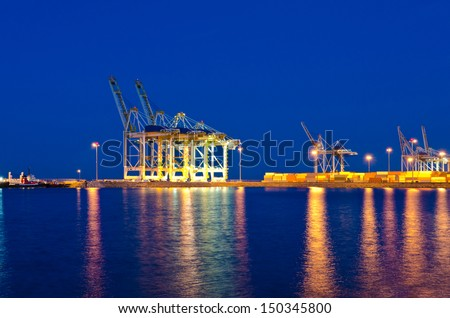 Container port terminal with cranes at sunset, sunrise, dawn, night time in Vancouver, Canada . - stock photo