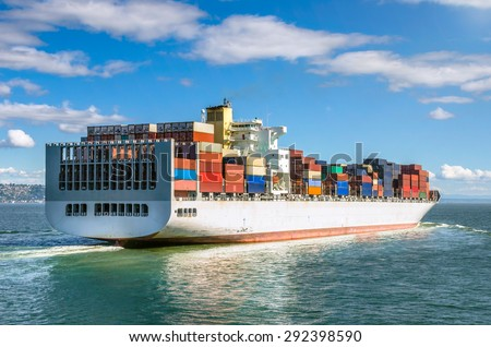 Container Ship and Blue Sky - stock photo