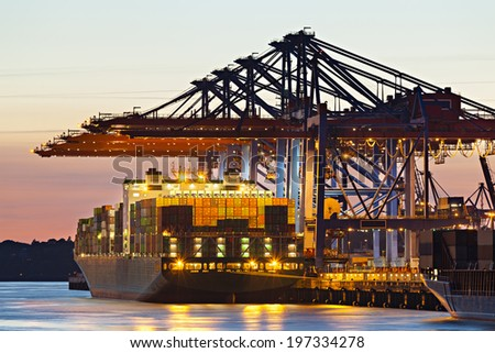 Container ship at a terminal at dusk