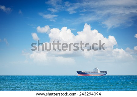Container ship at anchor on the horizon - stock photo