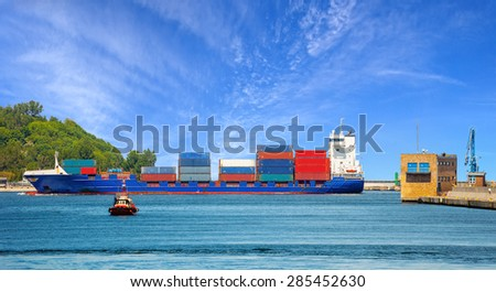 Container ship entering port of Gdynia, Poland.  - stock photo