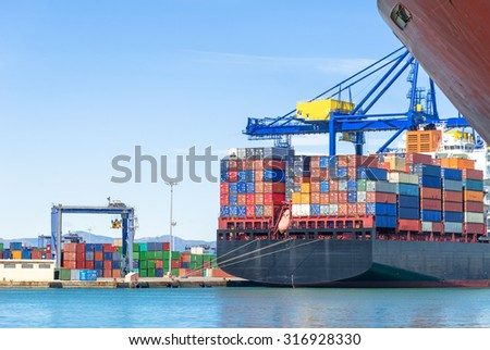 Container ship in harbor - stock photo