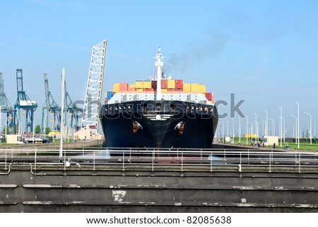 container ship in harbor sluice of antwerp - stock photo