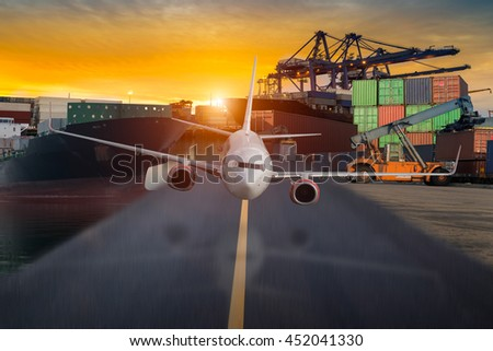 container ship in import,export port against beautiful sunset light of loading ship yard use for freight and cargo shipping vessel transport - stock photo