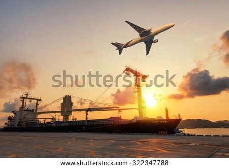 container ship in import,export port morning light of loading ship yard use for freight and cargo shipping vessel transport - stock photo