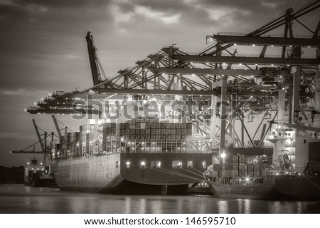 Container ship in the harbor of Hamburg. Black and White. - stock photo