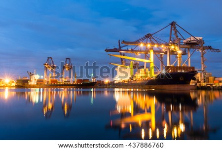 Container ship in the harbor of LeamChabang, night shot. Cloudy sky. - stock photo