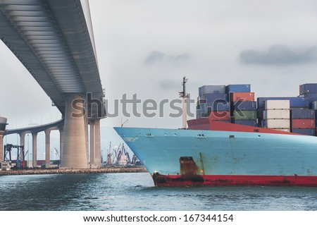 Container ship in Victoria Harbor of Hong Kong  - stock photo