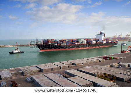 Container ship leaving port - stock photo