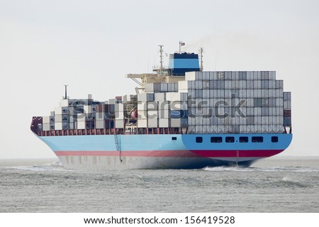 container-ship leaving the port of Antwerp,Belgium - stock photo