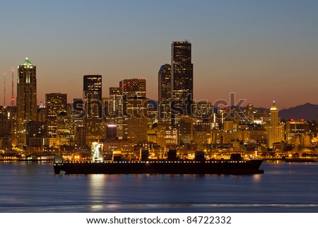 Container Ship on Puget Sound along Seattle Washington Skyline at Dawn