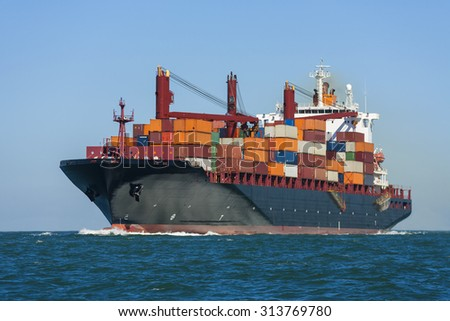 Container ship or boat sailing at sea - stock photo