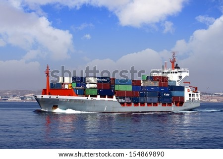 Container shp leaving port - stock photo