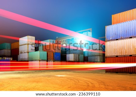 Container terminal at night, working in the bridge crane. - stock photo
