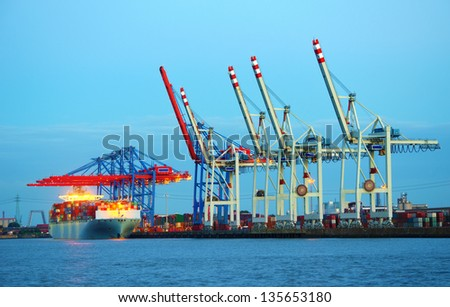 Container terminal in the harbor of Hamburg, Germany. - stock photo