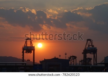 container terminal with sunset