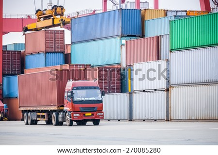 container transport area, a cargo containers truck with industrial crane loading - stock photo