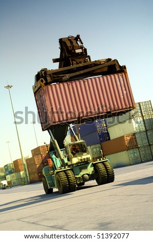 Container transport vehicle for transporting across  containers - stock photo