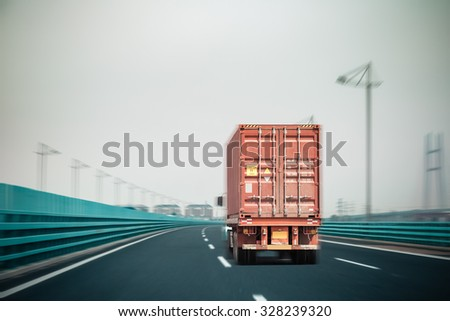 container truck on the bridge with motion blur , modern logistics background - stock photo